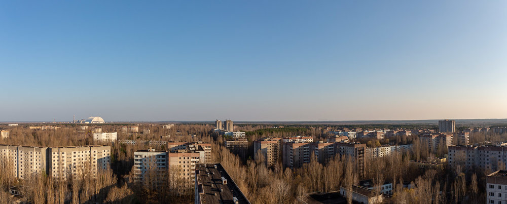 Pripyat City with the nuclear power plant and Duga Radar System in the distance
