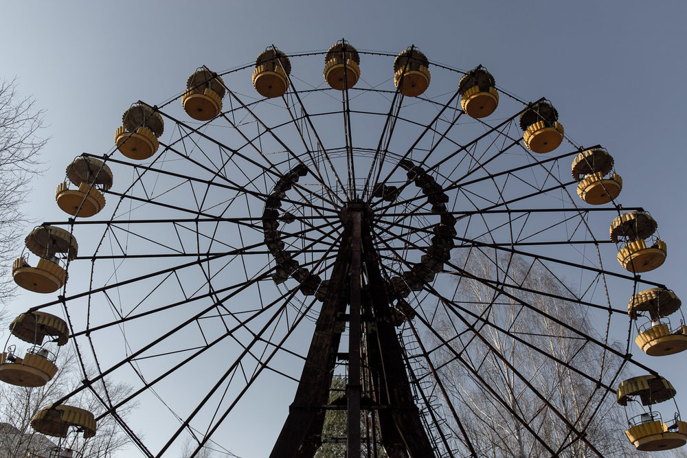 Ferris wheel at Pripyat amusement park in the sun with a blue sky