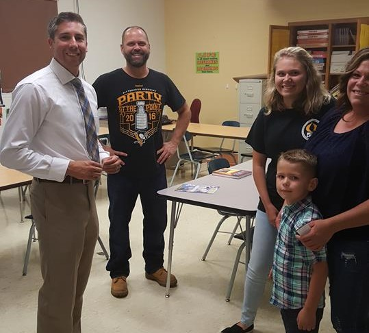 Mr. Ovial meets with happy parents