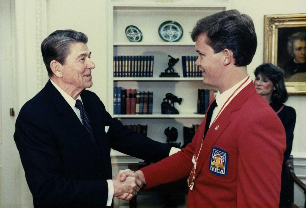President Ronald Reagan VICA's first international gold medalist, Dennis Falls from Scottsdale, Ariz. in the oval office.