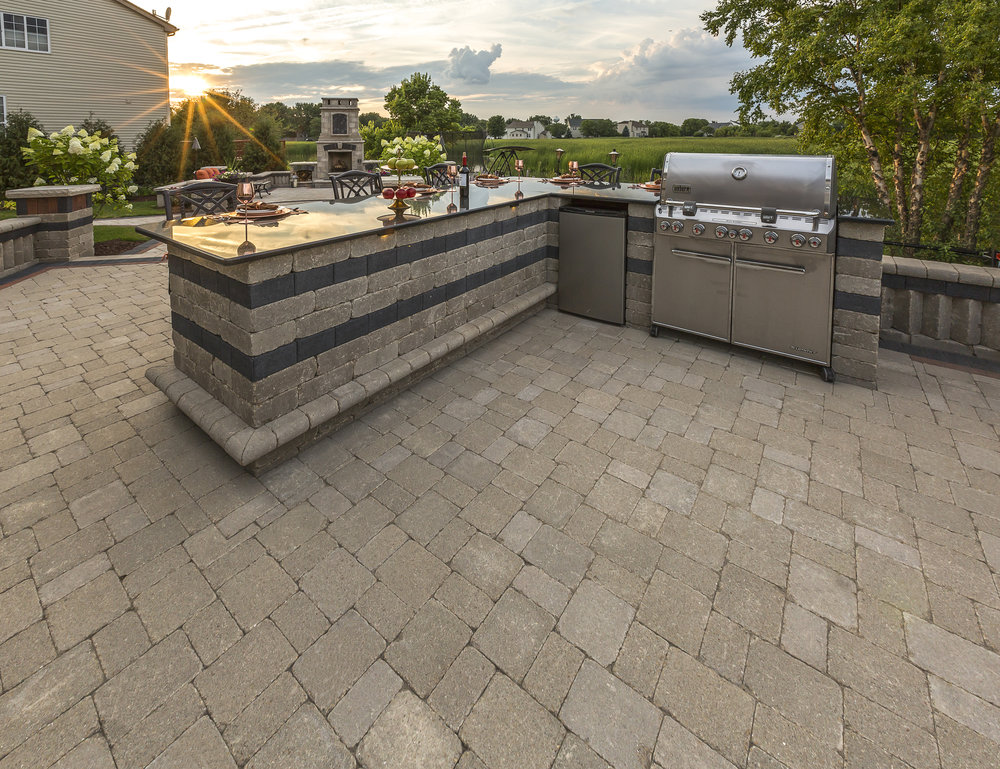 Custom outdoor kitchen with a dining area in Livingston County, MI