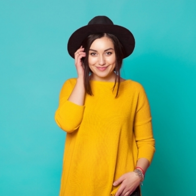 young-woman-wearing-casual-clothes-posing-over-green-wall-617383464_3005x2003.jpeg