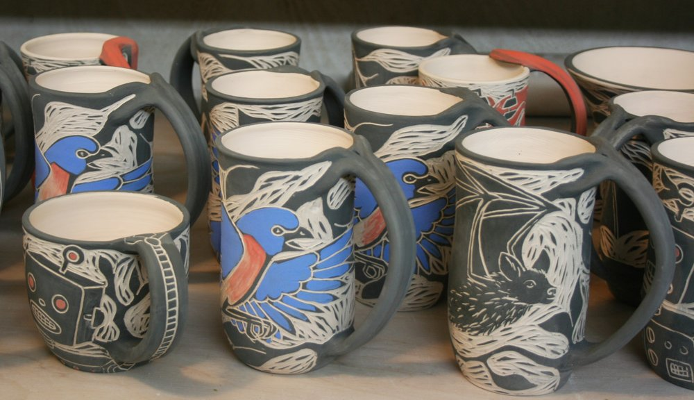 6) Bisque fire  - These mugs have now been fired for the first time, to cone 04 (1945 degrees) for approx 12 hours and are ready to be glazed once they have been cleaned of dust