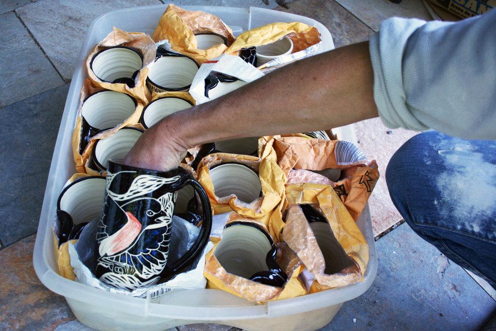 Mugs packed in padded envelopes for transport