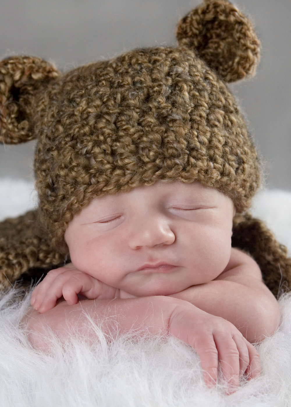 newbornphotographylansingmichiganokemosmichiganinfantbabyboyhatteddybearadorablecuteportrait.jpg