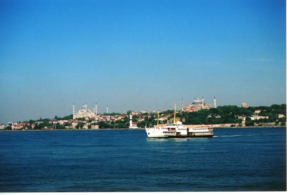 Ferry, Istanbul, Turkey, sometime between 2000-2002. It's been a while, but I suspect this ferry was headed to Kadikoy. I can't remember if ferries ran to Fenerbache or Bakirkoy. The Sultan Ahmet Mosque (Blue Mosque), Hagia Sophia, and Hagia Irene are visible in the distance.