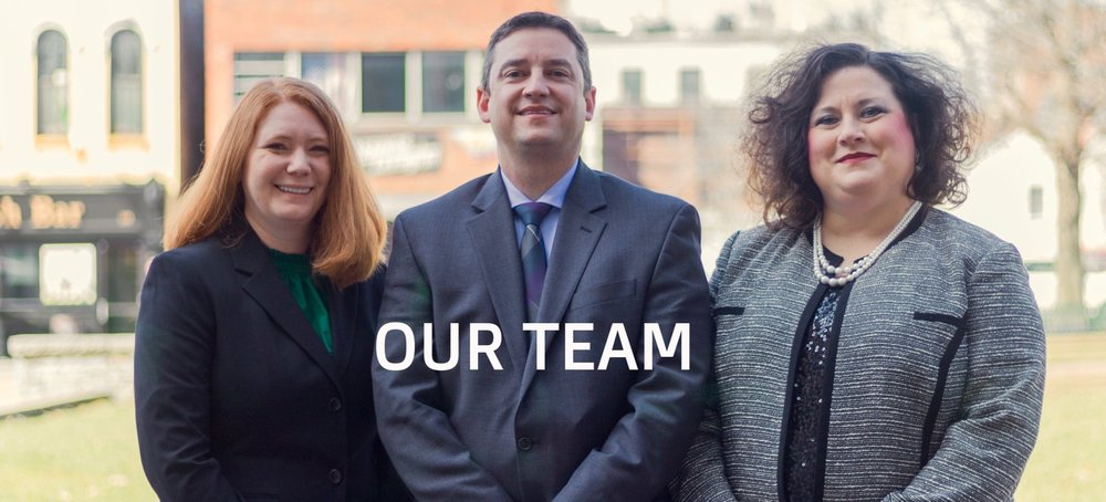 The team of Devine & Dominick, PLLC in Lexington, KY.  From left to right: Anna Dominick - Family Law Attorney.  Carl Devine - Family Law Attorney.  Angela Marshall - Paralegal.