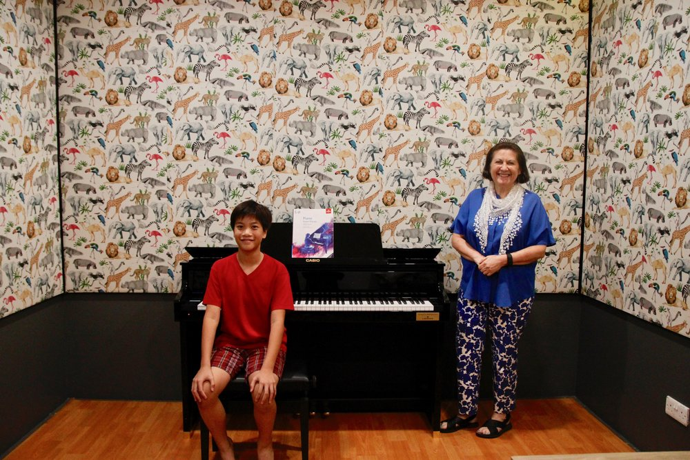 Joshua Hanitio, 12, and ABRSM examiner Tamandra Ford