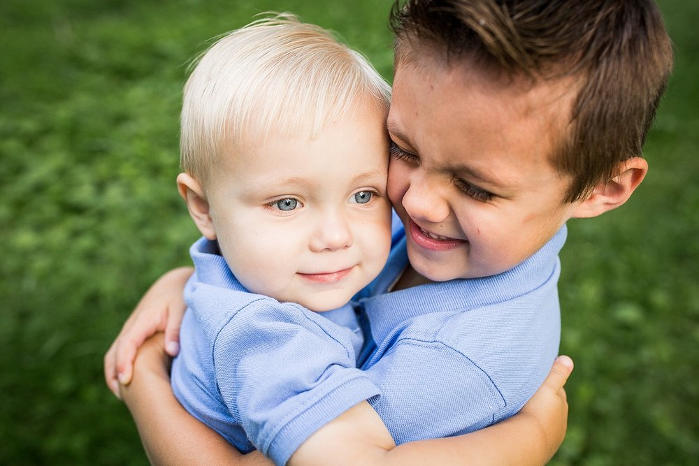 Photo of two little boys hugging each other.