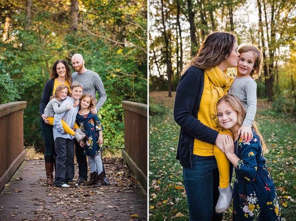 Photo of a family of five standing in the golden fall light hugging and smiling.