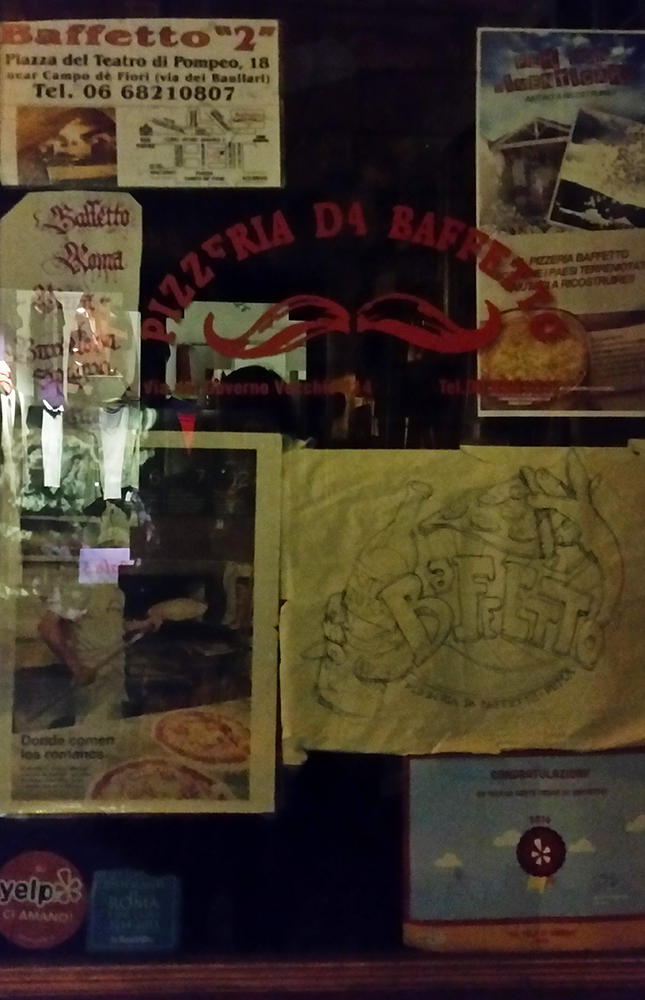 Sadly, this picture is our one, blurry memento of the sublime Pizzeria da Baffetto.