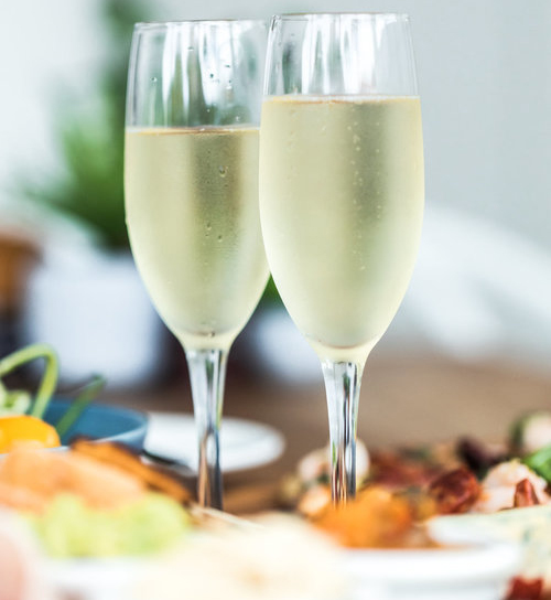 2 glasses of sparkling wine served at The Central Hotel Port Douglas.