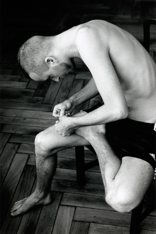 Wolfgang Tillmans,  Anders pulling splinter from his foot , 2004