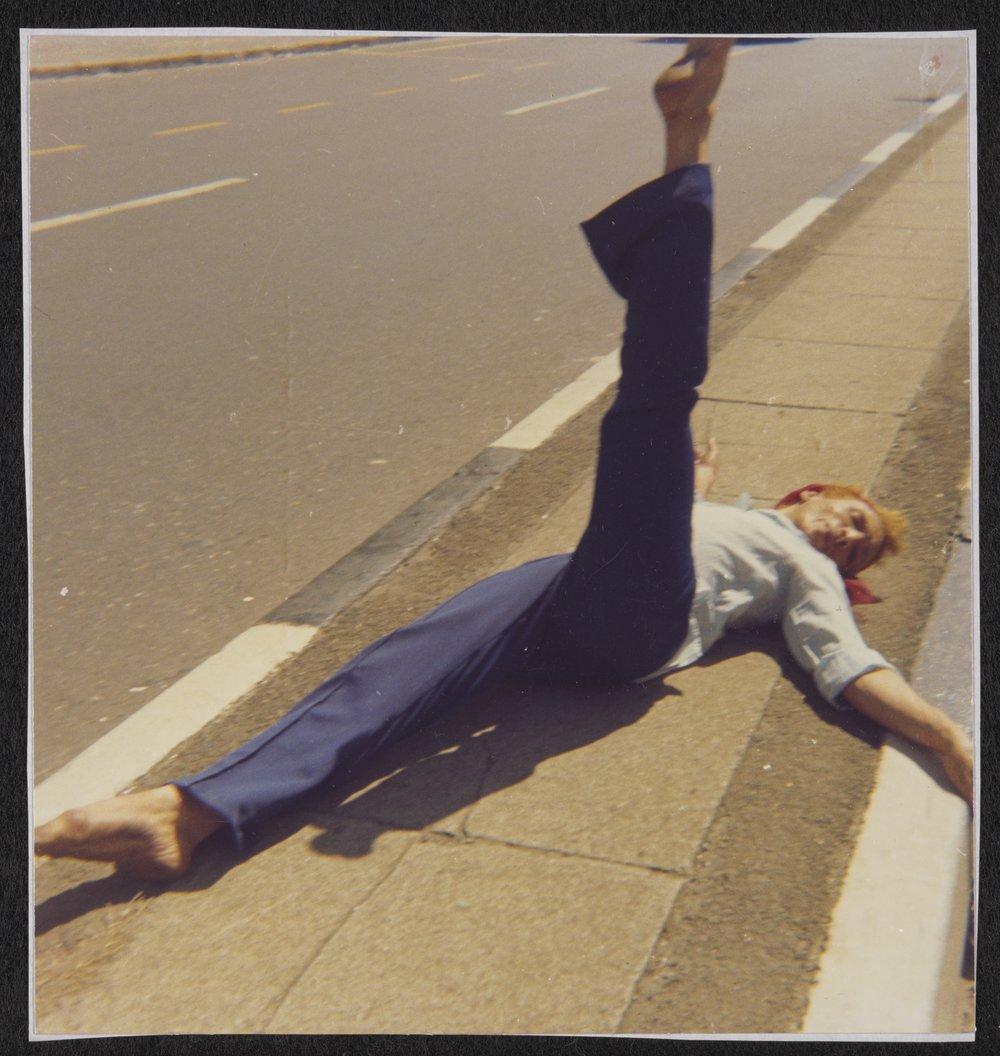 Kewpie Lying on a Sidewalk