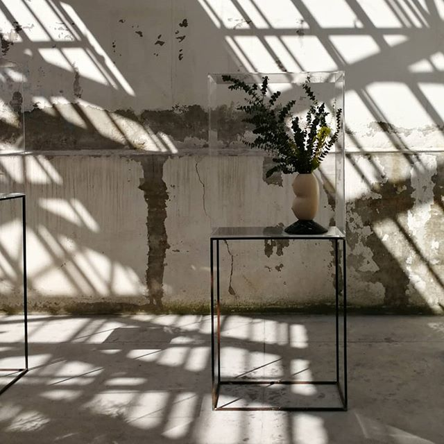 Shadow play at Alcova - a beautiful show in a former Milanese panettone factory. Vase by @valentinacameranesi with @blocstudios