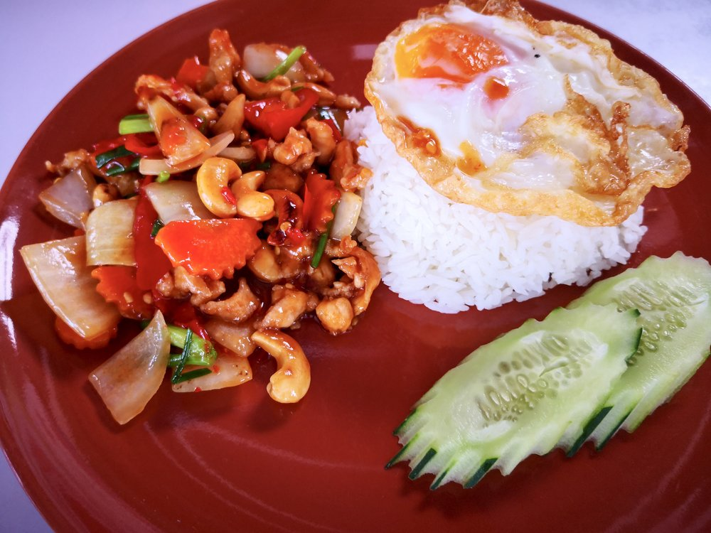 Stir-fried chicken with cashew nuts, and of course rice with egg on top