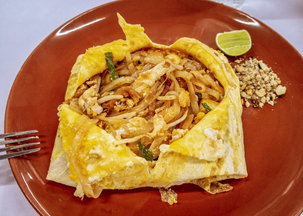 Pad Thai in Omelette with lime and nuts - stir-fried rice noodles with chicken, veggies and egg, the quickest Thai dish probably