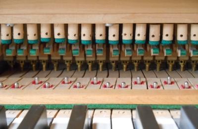 Preparing to regulate a grand piano.