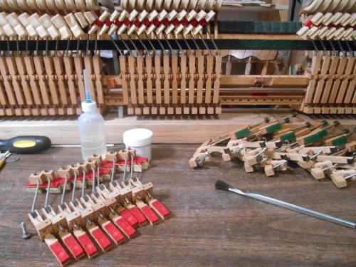 Refurbishing a spinet piano action.