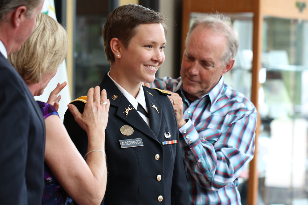 Addyson Albershardt stands with her parents during her commission into the US Army.