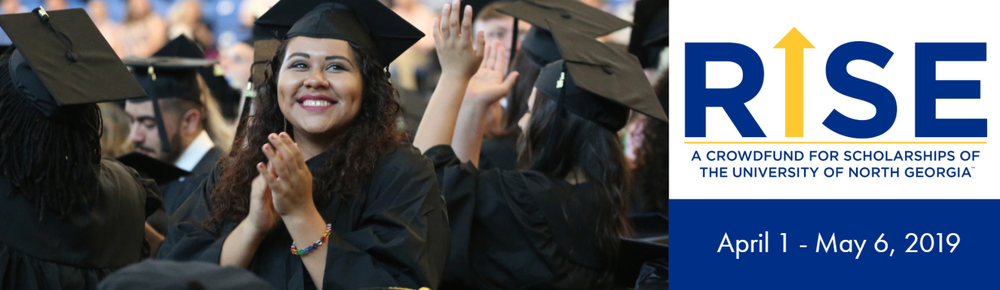 Graduate claps her hands after she graduates from the University of North Georgia.