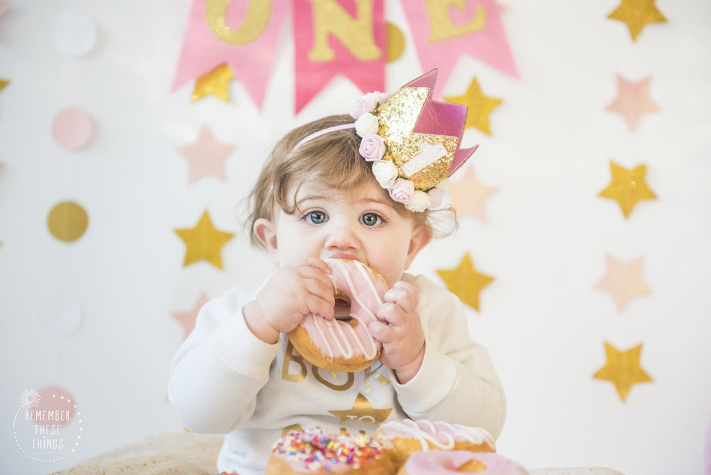 She clearly enjoyed the doughnuts for her one year shoot!