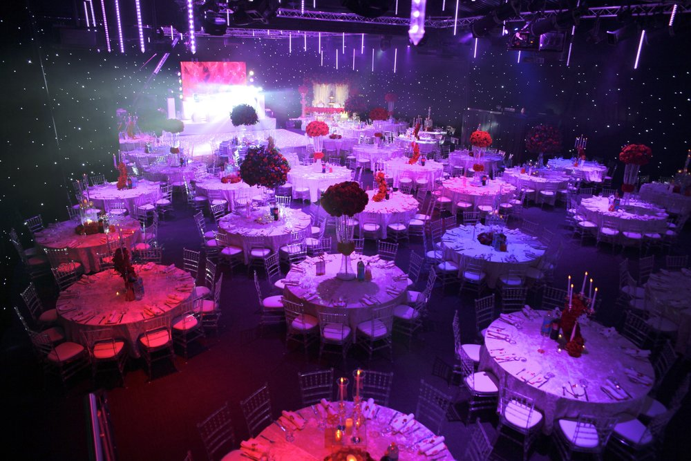 The Colour Palette - The venue had AV production, so we were able to bring in the romance red. The red contrasted against the venue's black star cloth whilst having the room colour washed in pink added to the atmosphere.
