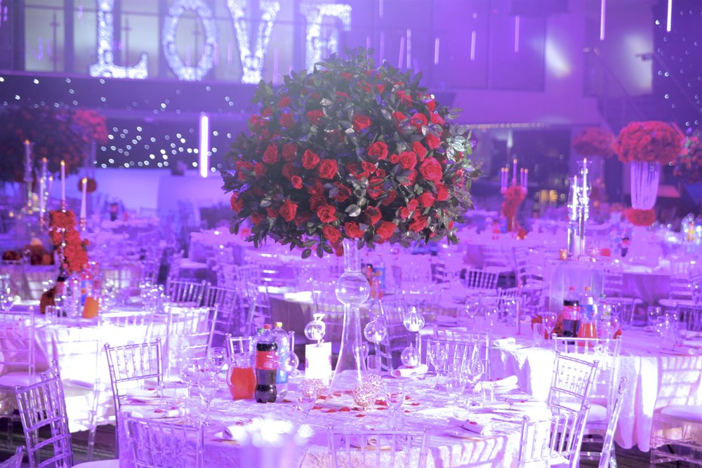 Centrepieces - We had a variety of four Centrepiece designs all of which shared the red floral design with accents of candlelit. This allows for various heights with different details in order to meet all kinds of budgets.