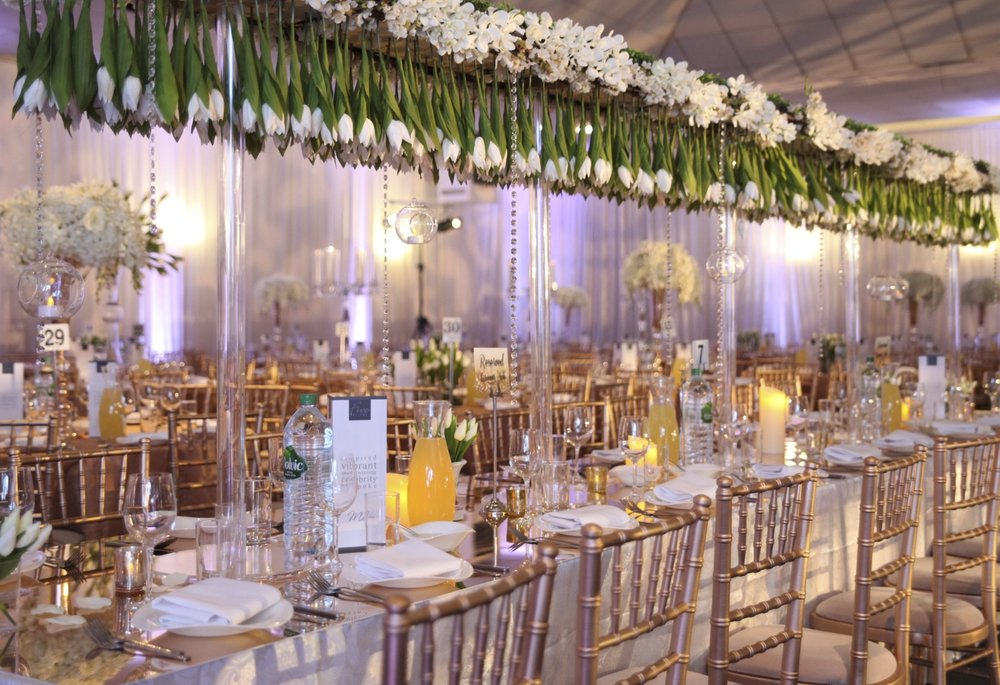 Tulip Crazy - Snob Events allowed us to create signature family tables with rows of suspended tulips. We used gold mirror tabletops to contrast with the theme, giving the clients the wow look required.
