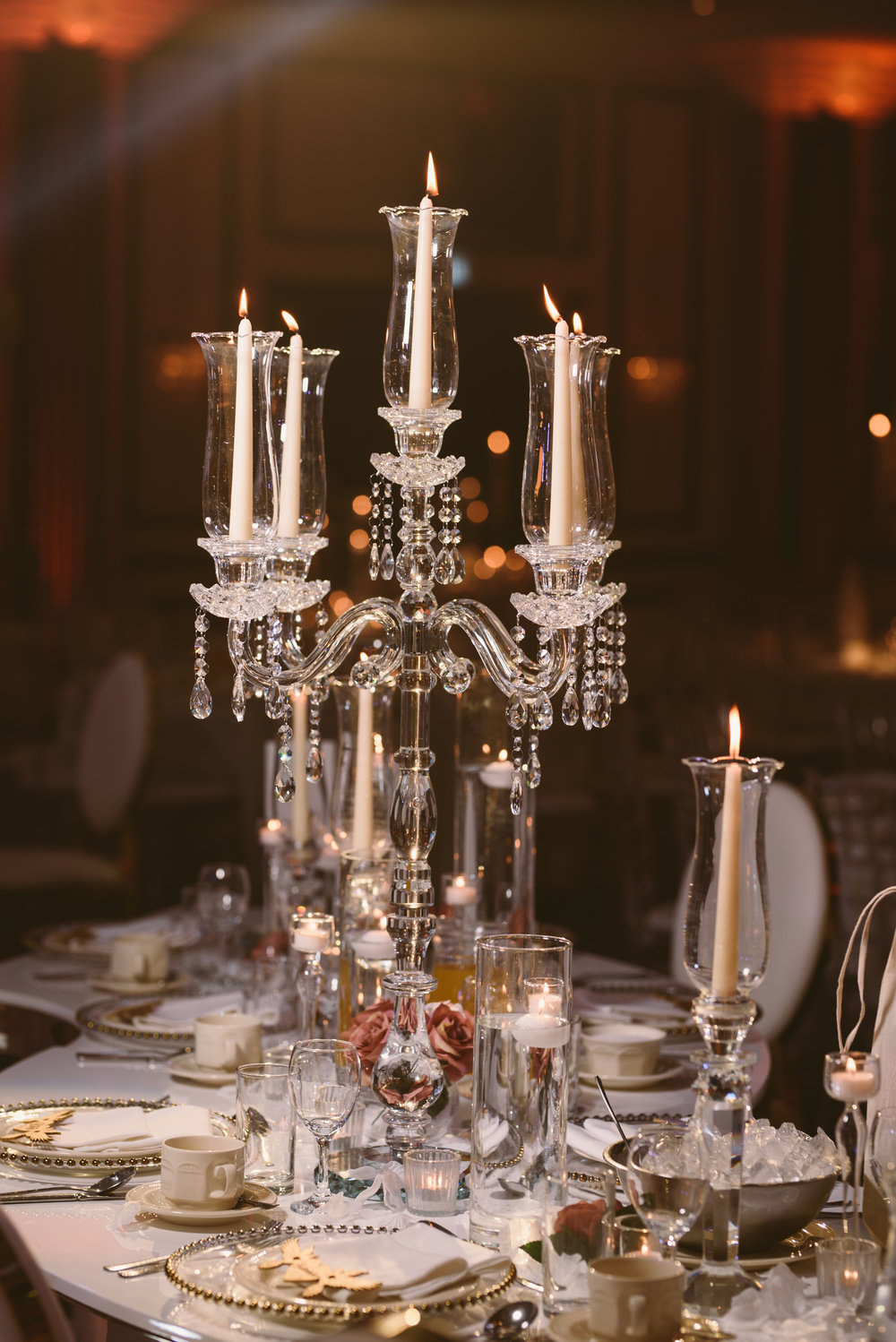 Glassware - The glassware was incorporated from the Centrepieces right through to the concept of the floating floral head-table design.