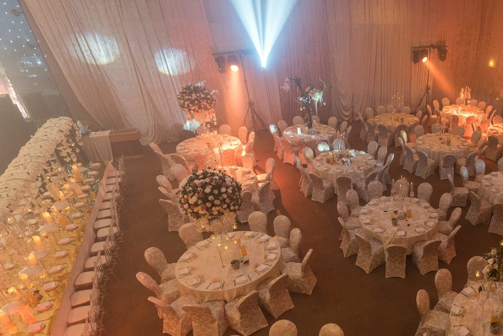 Bespoke Draping - Incorporating our 'Blush & Classy' look, we suggested bespoke draping for the venue in Champagne Crush Velour. This involved site visits to get the sizing for the bespoke draping, which would hide the brick walls and let us start from a blank canvas.