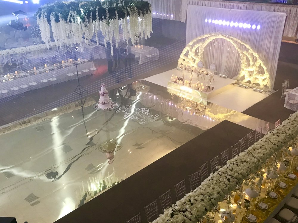 Room Layout - The Broadway Suite is a large space meaning that we had the creative freedom to go for large signature family tables to give an intimate yet spacious feel, with the head table occupying a prominent space at the end of the dance floor.