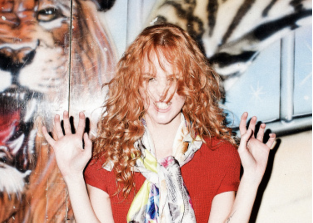 woman with ginger hair growling like a tiger.png