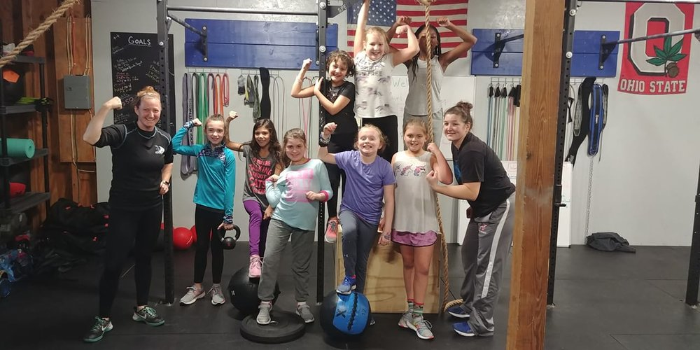 Girl Scouts earning fitness badge