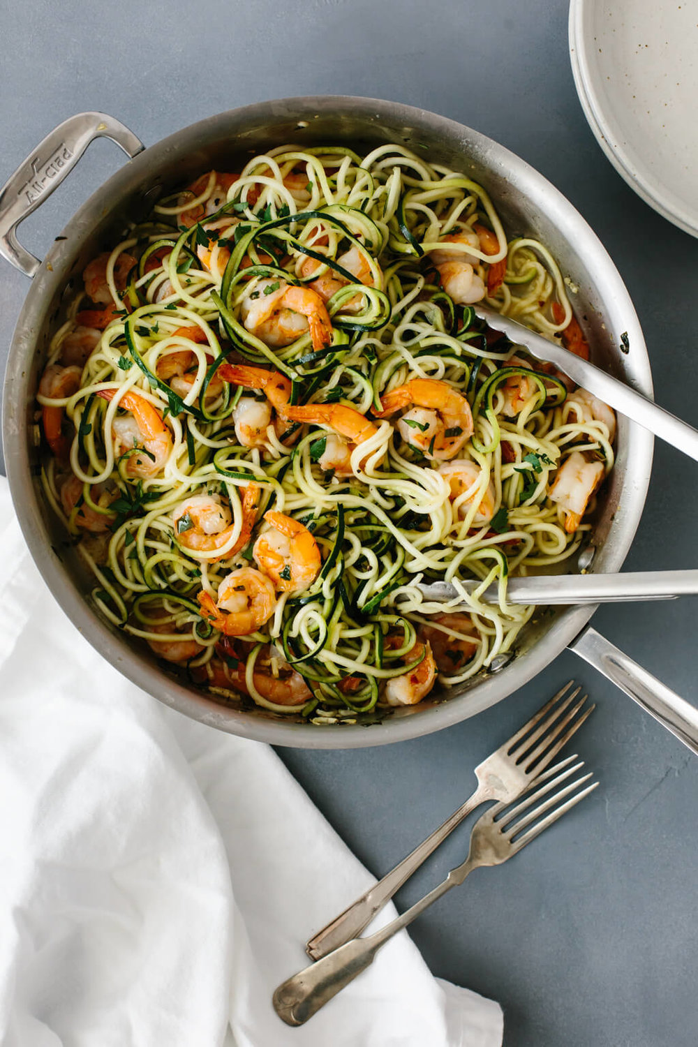 Zucchini Pasta with Lemon garlic shrimp - Recipe from: DownshiftologyUse ghee instead of butter and broth instead of white wine to keep whole30