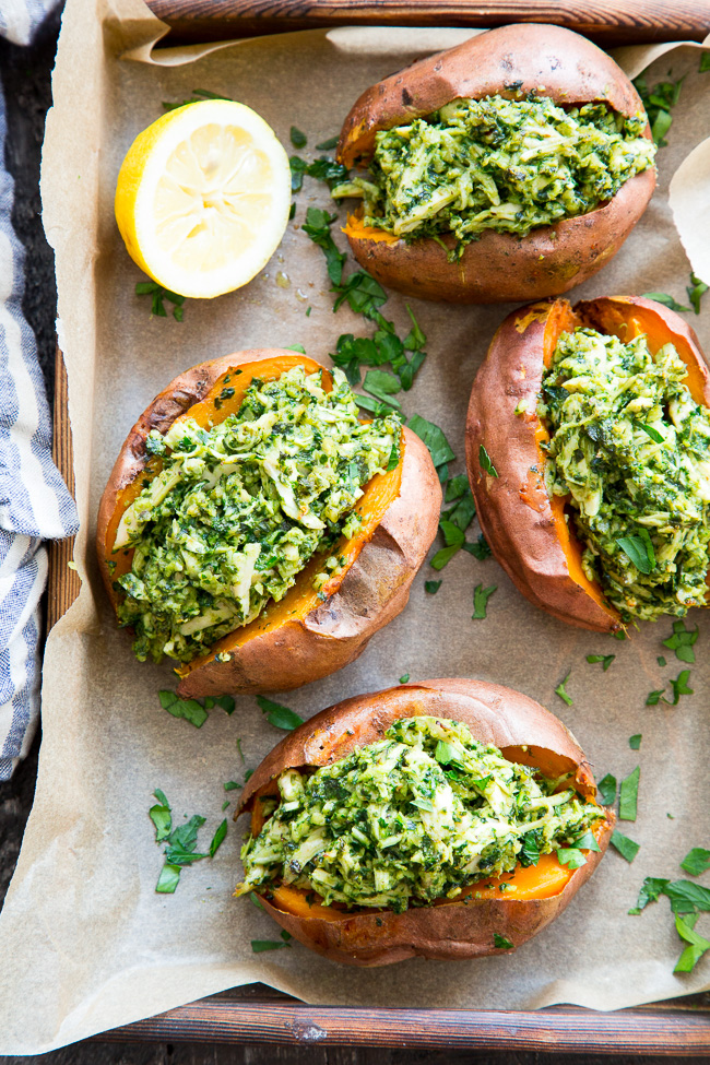 Pesto chicken stuffed sweet potatoes - Recipe by: Paleo Running Mamma Replace walnuts with cashews; or use Trader Joes vegan pesto!