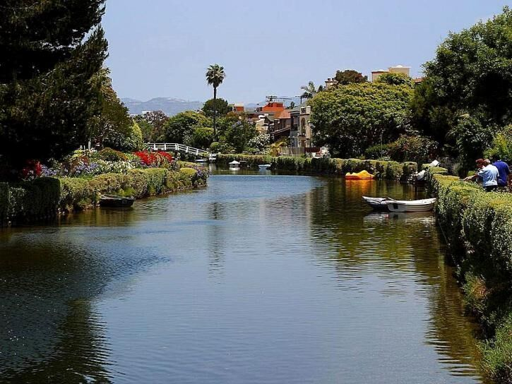Whether above it or below, the Venice Canals Walkway provides an incredible view. Enjoy! #canal #venice #cali #socal #canoes