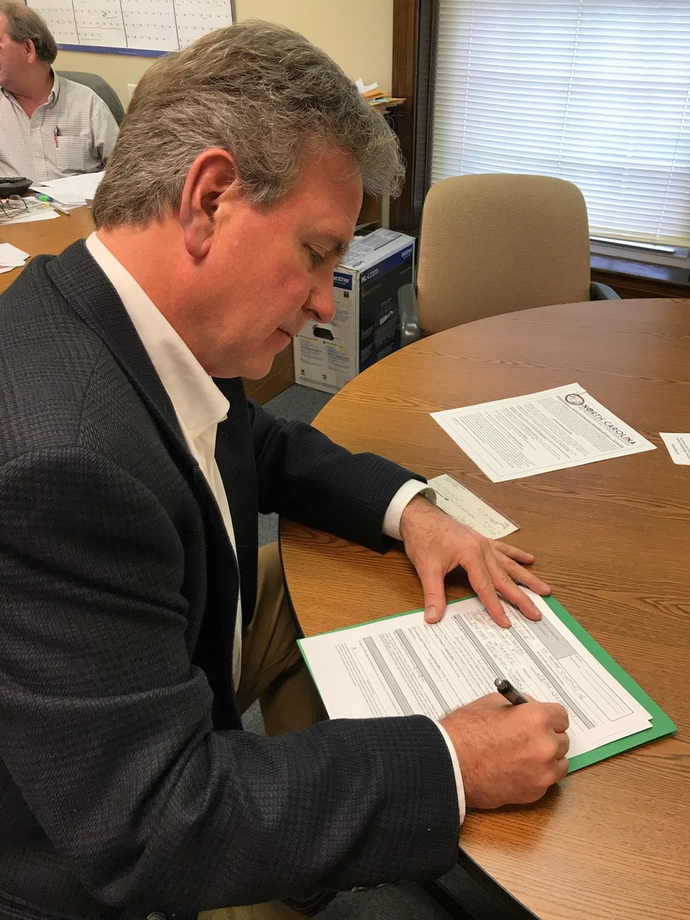 John filing his official forms to run for office