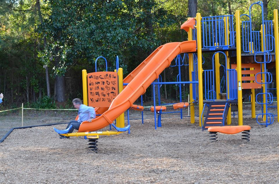Johnson having fun on the newly constructed playground at Willard Outreach