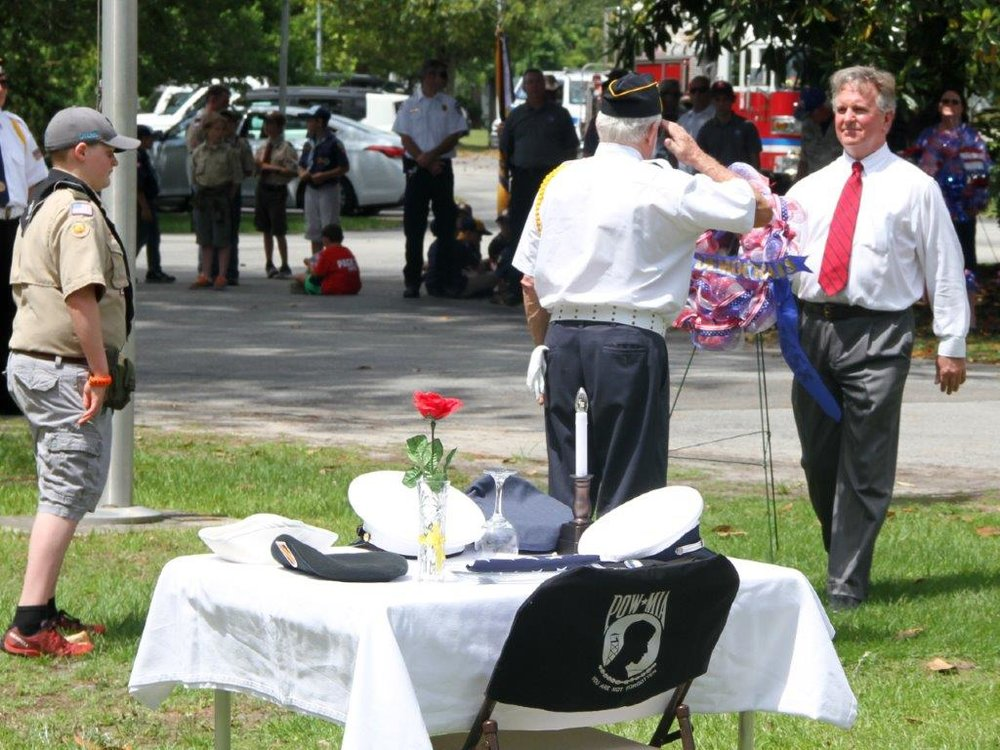 John, proud father of Lt.JG in the US Navy, presents the wreath donated by the Pender County Democratic Party