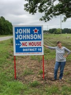 A proud owner of John's campaign street signs!