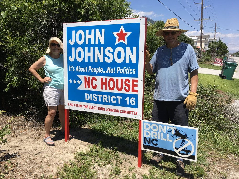 Proud owners of a Johnson street sign, Becky and Dan Drake