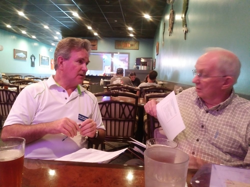 Discussing local issues with a Hampstead resident at Homeport Restaurant