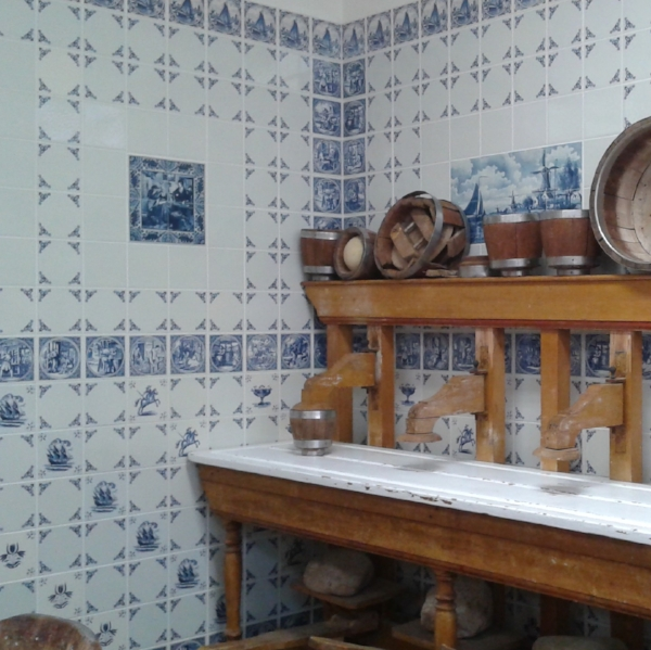 Delftware tiles tell stories of traditional farm labors and crafts.