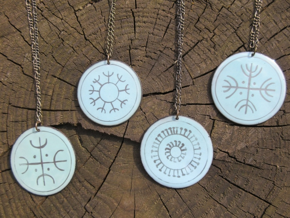Enameled copper pendants derive meaning from symbols of solar worship, like fireworks in July.