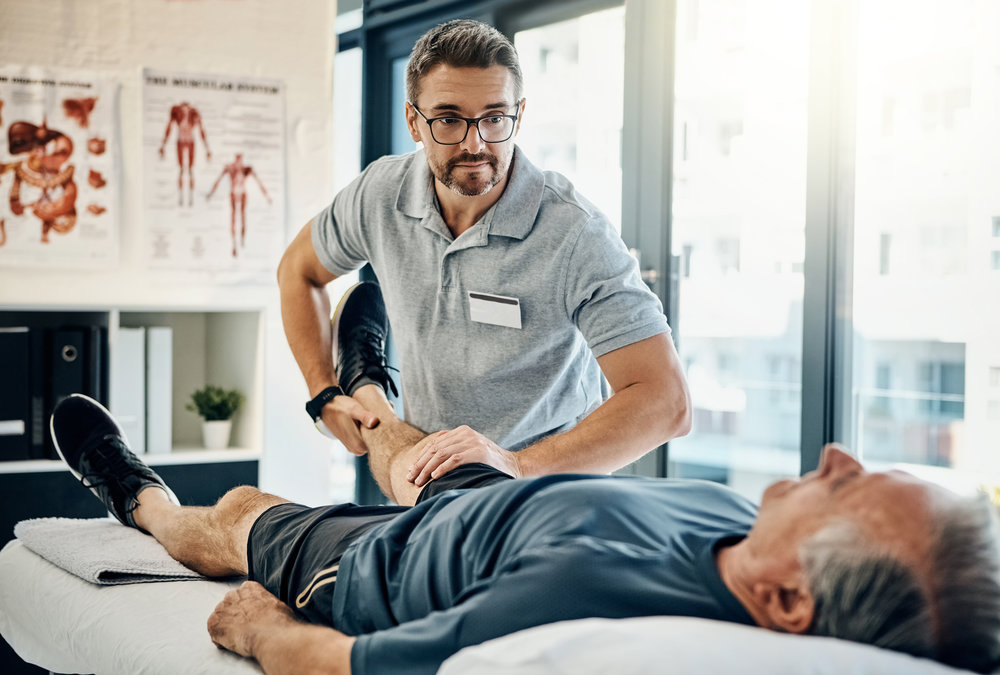 Therapist helping stretch patient
