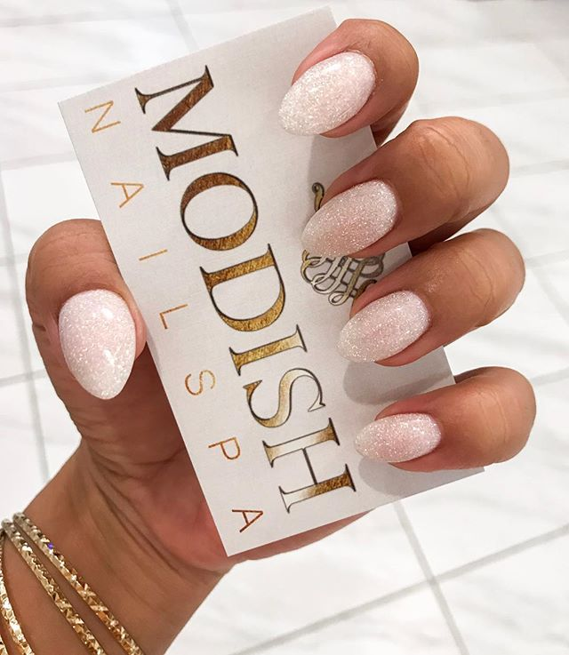 ✨ Crystal nails as glammed as the new year ball! What are your new year's resolutions? ✨ . #ModishNailSpa #dippowdernails #sparkle