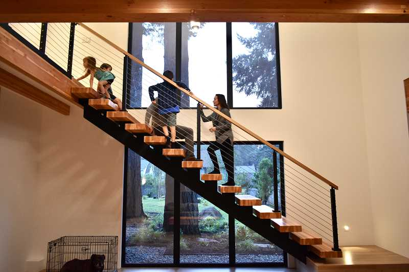 WHEN THE ANTONINI FAMILY FIRST MOVED IN TO THEIR ZERO-ENERGY HOME IN LAKE OSWEGO, THE CHILDREN FEARED THE OPEN STAIRCASE. IT'S NO LONGER A SCARY FEAT TO CLIMB THE STARIS THAT CONNECT THE CHILDREN'S BEDROOMS TO THE MAIN FLOOR.