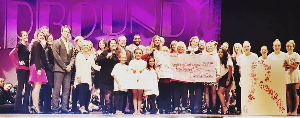 with my entire Starbound Family and the giant check of the money raised in just one day.