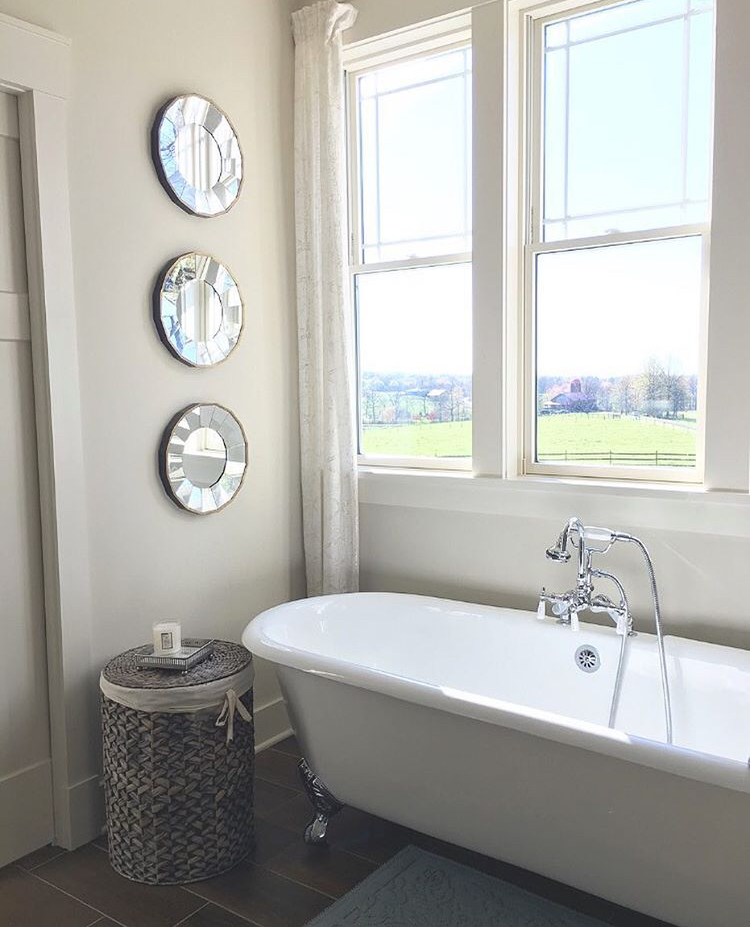Modern farmhouse bathroom with clawfoot tub.